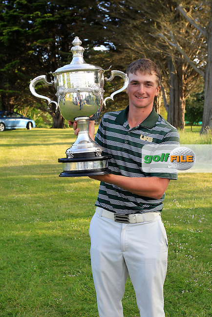 Paul Dunne with the cup<br /> during the 3rd round of the East of Ireland Amateur Open Championship 2013 Co Louth Golf club 3/6/13<br /> Picture:  Thos Caffrey / www.golffile.ie