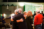 "Larry Winters (C), Vietnam Veteran and author of ""The Making and Un-Making of A Marine,"" hugs a participant after the Veteran-Civilian Dialogue at Intersections International on February 4, 2011 in New York City.  (PHOTOGRAPH BY MICHAEL NAGLE)"