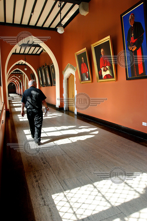 A priest walks through the corridors of St Patrick's College in Maynooth. The college was founded in 1795 as the National Seminary for Ireland, however, recent years the Catholic church has seen a rapid decline in the number of young men entering the priesthood and many dioceses now face a shortage of priests..