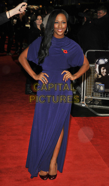 """Alexandra Burke .The """"Michael Jackson : The Life Of An Icon"""" UK premiere, Empire cinema, Leicester Square, London, England..2nd November 2011.full length purple dress hands on hips poppy slit split.CAP/CAN.©Can Nguyen/Capital Pictures."""