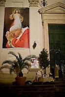 Nuns sleeping under a banner  of Pope John Paul II on the day of his beatification ceremony at the Vatican..Alcune suore dormono sotto una foto gigante di Giovanni Paolo II il giorno della cerimonia per la sua Beatificazione in Vaticano