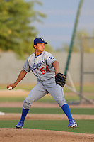 Victor Arano #54 of the AZL Dodgers pitches against the AZL Athletics at Phoenix Municipal Stadium on July 10, 2013 in Phoenix, Arizona. AZL Athletics defeated the AZL Dodgers, 7-1. (Larry Goren/Four Seam Images)