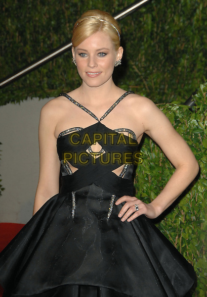 ELIZABETH BANKS.The 2010 Vanity Fair Oscar Party held at The Sunset Tower Hotel in West Hollywood, California, USA..March 7th, 2010.oscars half length black pleats dress hand on hip.CAP/RKE/DVS.©DVS/RockinExposures/Capital Pictures.