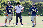 Costa Mesa, CA 03/08/14 - Trevor Brosco (Notre Dame #34), Nick Ossello (Notre Dame #20) and Notre Dame coach<br />  in action during the Notre Dame Irish and Denver Pioneers NCAA Men's lacrosse game at LeBard Stadium in Costa Mesa, California as part of the 2014 Pacific Coast Shootout.  Denver defeated Notre Dame 10-7 in front of a crowd of over 5800 spectators.