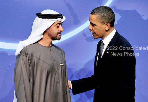United States President Barack Obama welcomes Sheikh Mohamed bin Zayed Al Nahyan, Crown Prince of Abu Dhabi and Deputy Supreme Commander of the United Arab Emirates (UAE) Armed Forces to  the Nuclear Security Summit at the Washington Convention Center, Monday, April 12, 2010 in Washington, DC. .Credit: Ron Sachs / Pool via CNP