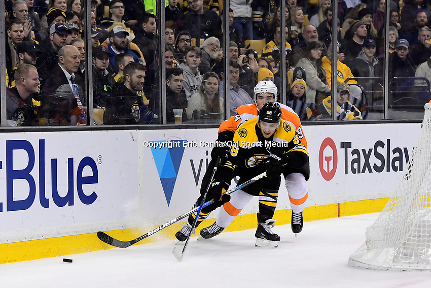March 8, 2018: Philadelphia Flyers defenseman Ivan Provorov (9) stick checks Boston Bruins right wing David Pastrnak (88) during the NHL game between the Philadelphia Flyers and the Boston Bruins held at TD Garden, in Boston, Mass. Boston defeats Philadelphia 3-2 in regulation time. Eric Canha/CSM