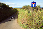 No through road sign and country lane, Trefin, Pembrokeshire, Wales