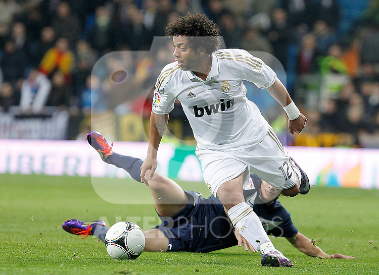 Real Madrid's Marcelo Vieira (f) and Malaga's Seba Fernandez during Spanish King's Cup match.January 3,2011. (ALTERPHOTOS/Acero)