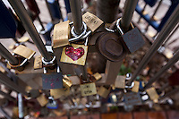 09 SEP 2010 - BUDAPEST, HUN - Padlocks chained to a metal frame to signal couples love for each other (PHOTO (C) NIGEL FARROW)