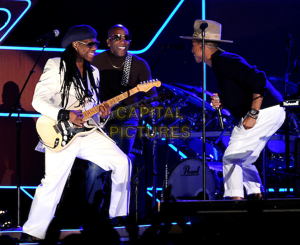 LOS ANGELES, CA - JANUARY 26 : Nile Rodgers (L) of 'Daft Punk' and Pharrell Williams (R) perform onstage at The 56th Annual GRAMMY Awards at Staples Center on January 26, 2014 in Los Angeles, California.<br /> CAP/MPI/PG<br /> &copy;PGFMicelotta/MediaPunch/Capital Pictures