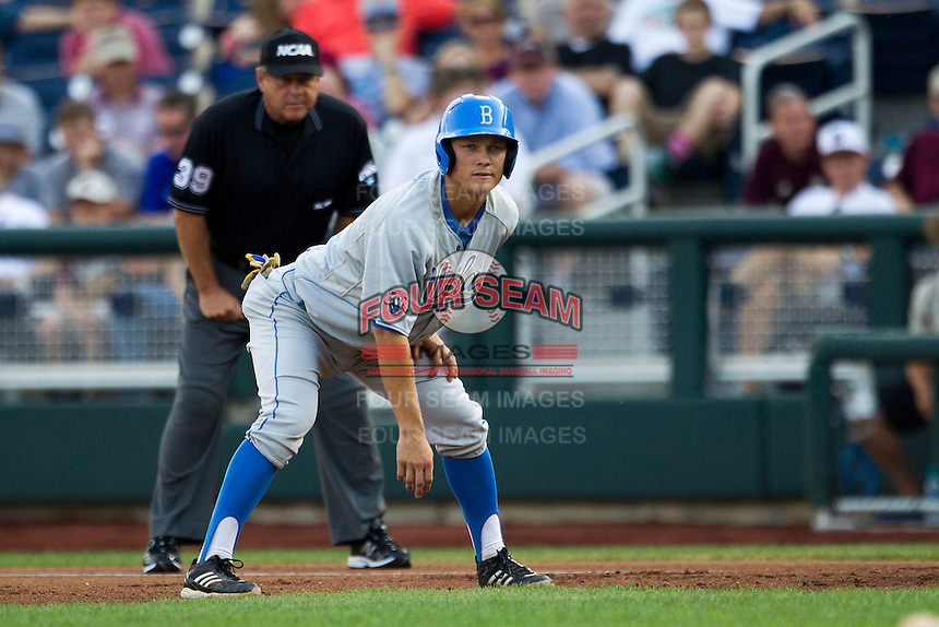 UCLA shortstop Pat Valaika (10) takes his lead off of first base during Game 1 of the 2013 Men's College World Series Finals against the Mississippi State Bulldogs on June 24, 2013 at TD Ameritrade Park in Omaha, Nebraska. The Bruins defeated the Bulldogs 3-1, taking a 1-0 lead in the best of 3 series. (Andrew Woolley/Four Seam Images)