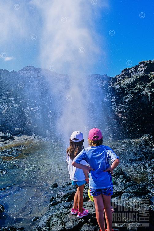 Girls watch the Nakalele blowhole