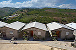 "Some houses in a model resettlement village constructed by the Lutheran World Federation in Gressier, Haiti. The settlement houses 150 families who were left homeless by the 2010 earthquake, and represents an intentional effort to ""build back better,"" creating a sustainable and democratic community."