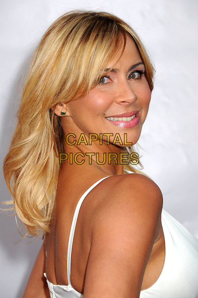 "AYLIN MUJICA.The Cable Show 2010 ""An Evening with NBC Universal"" held at Universal Studios Hollywood, Universal City, California, USA..May 12th, 2010.headshot portrait white side looking over shoulder .CAP/ADM/BP.©Byron Purvis/AdMedia/Capital Pictures."