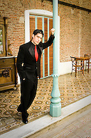 Argentina, Buenos Aires, Tango dancer, solo portrait, young man leaning on post