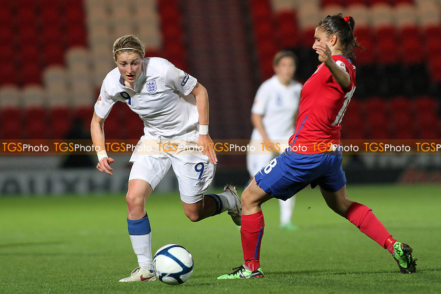 Ellen White of England and Jovana Damnjanovic of Serbia - England Women vs Serbia Ladies - UEFA Euro 2013 Group 6 Qualifier at Keepmoat Stadium, Doncaster Rovers FC - 23/11/11 - MANDATORY CREDIT: Gavin Ellis/TGSPHOTO - Self billing applies where appropriate - 0845 094 6026 - contact@tgsphoto.co.uk - NO UNPAID USE.