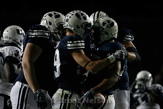 BYU's Harvey Unga (right) celebrates his touchdown with teammate Luke Ashworth. BYU vs. Utah State University college football Friday, October 2 2009 in Provo.