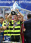 Huddersfield's Chris Loewe celebrates with the trophy during the Championship Play-Off Final match at Wembley Stadium, London. Picture date: May 29th, 2017. Pic credit should read: David Klein/Sportimage