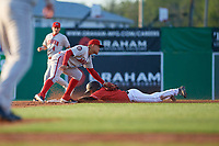 Auburn Doubledays shortstop Jose Sanchez (44) tags J.D. Orr (22) out on a stolen base attempt during a NY-Penn League game against the Batavia Muckdogs on June 18, 2019 at Dwyer Stadium in Batavia, New York.  Batavia defeated Auburn 7-5.  (Mike Janes/Four Seam Images)