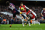 Ryan Shotton of Stoke City vies for the ball with Alex Oxlade Chamberlain during the  English Premier League soccer match between Arsenal and Stoke City in London,UK,02 February  2012.THOMAS CAMPEAN/Pixel8000 Ltd...