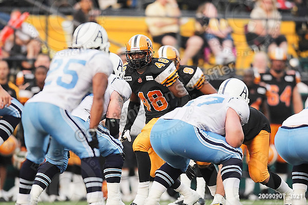 September 7, 2009; Hamilton, ON, CAN; Hamilton Tiger-Cats linebacker Yannick Carter (48). CFL football - the Labour Day Classic - Toronto Argonauts vs. Hamilton Tiger-Cats at Ivor Wynne Stadium. The Tiger-Cats defeated the Argos 34-15. Mandatory Credit: Ron Scheffler.