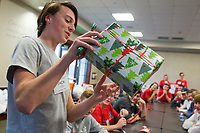 NWA Democrat-Gazette/CHARLIE KAIJO Jack Van Hecke, 16 of Bentonville demonstrates how to curl a ribbon on Sunday, November 12, 2017 at the Circle of Life Hospice meeting room in Bentonville. Ninth and tenth grade boys from the Ozark Chapter of Young Men's Service League created care packages to send to a troop of 50 soldiers stationed in Kandahar, Afghanistan. Immediately prior to the service project, they heard firsthand experiences from a military veteran who was stationed in Kandahar.