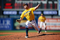 Michigan Wolverines relief pitcher William Tribucher (22) delivers a pitch during a game against Army West Point on February 17, 2018 at Tradition Field in St. Lucie, Florida.  Army defeated Michigan 4-3.  (Mike Janes/Four Seam Images)