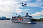 A float plane flies over a cruise ship near Ketchikan, Alaska.