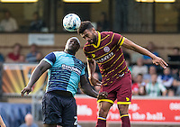 Adebayo Akinfenwa of Wycombe Wanderers and Steven Caulker of QPR during the Pre-Season Friendly match between Wycombe Wanderers and Queens Park Rangers at Adams Park, High Wycombe, England on the 22nd July 2016. Photo by Liam McAvoy / PRiME Media Images.