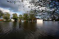 The Mississippi River floods the Red Star district in Cape Girardeau, MO, on Thursday, April 28, 2011.