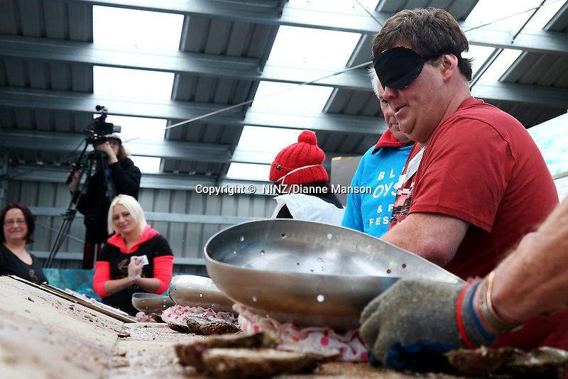 Shane Wixon (Ngai Tahu), of Invercargill, shucks oysters blindfolded during the oyster opening competition at the Bluff Oyster and Food Festival, Bluff, New Zealand, Saturday, May 21, 2016. Credit:  Dianne Manson