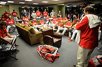 The clubhouse manager of the Greenville Drive, right, explains team rules in the clubhouse on the team's Media Day first workout on Tuesday, April 1, 2014, at Fluor Field at the West End in Greenville, South Carolina. (Tom Priddy/Four Seam Images)