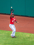 26 July 2013: Washington Nationals outfielder Denard Span pulls in a fly ball during a game against the New York Mets at Nationals Park in Washington, DC. The Mets shut out the Nationals 11-0 in the first game of their day/night doubleheader. Mandatory Credit: Ed Wolfstein Photo *** RAW (NEF) Image File Available ***