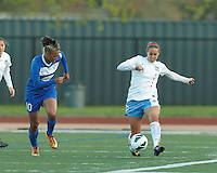 Chicago Red Stars midfielder Leslie Osborne (12) passes the ball as Boston Breakers forward Lianne Sanderson (10) closes. In a National Women's Soccer League Elite (NWSL) match, the Boston Breakers (blue) defeated Chicago Red Stars (white), 4-1, at Dilboy Stadium on May 4, 2013.