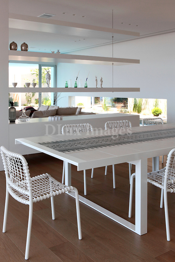 open plan white dining room