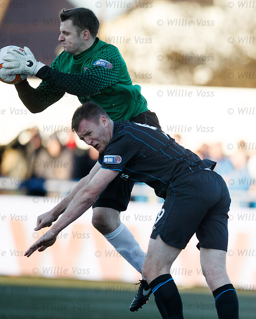 Kevin Kyle gets a sore one in the face from Montrose goalie Sandy Wood