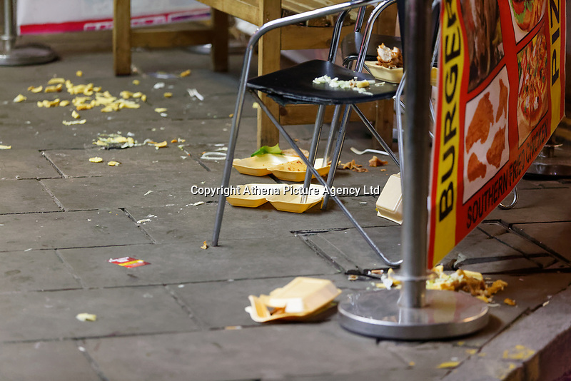 Pictured: Discarded take-away food on the pavement. Friday 14 December 2018<br /> Re: Revellers in Wind Street, Swansea, Wales, UK.