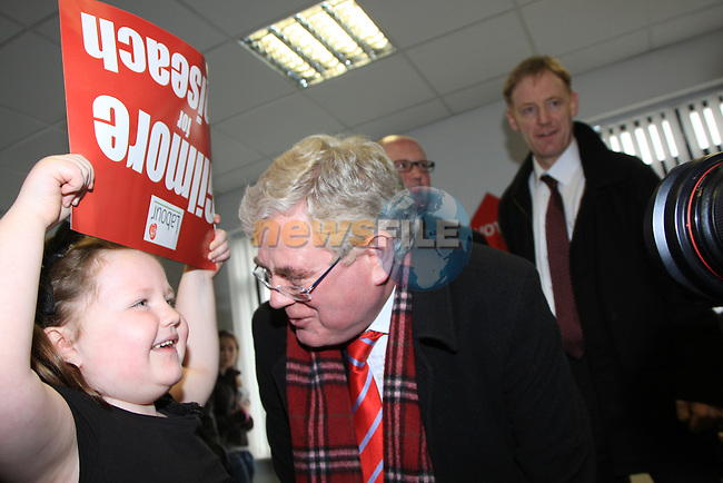 "Labour Leader Eamon Gilmore TD arrived in Drogheda go Give the Local Election Canidate Ged Nash a helping start to his election campaign..Ella Donnelly holds a poster aloft ""Gilmore for Taoiseach"" as Eamon Gilmore shows a big smile on his face..Picture Fran Caffrey/www.newsfile.ie."