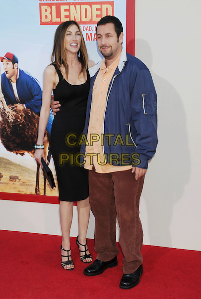 HOLLYWOOD, CA- MAY 21: Actor Adam Sandler (R) and Jackie Sandler arrive at the Los Angeles premiere of 'Blended' at TCL Chinese Theatre on May 21, 2014 in Hollywood, California.<br /> CAP/ROT/TM<br /> &copy;Tony Michaels/Roth Stock/Capital Pictures