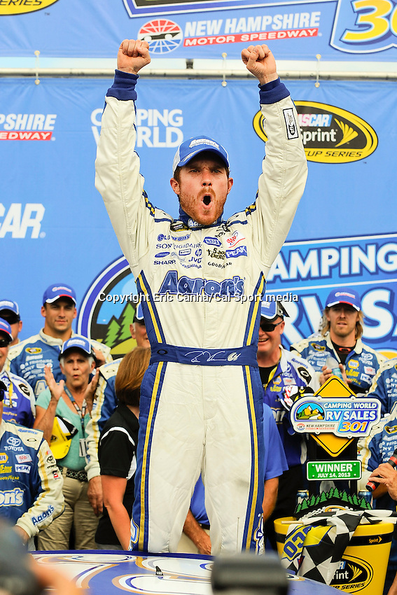 July 14, 2013 - Loudon, New Hampshire U.S. - Sprint Cup Series driver Brian Vickers (55) celebrates on top of his car after winning the NASCAR Sprint Cup Series Camping World RV Sales 301 held at the New Hampshire Motor Speedway in Loudon, New Hampshire.   Eric Canha/CSM