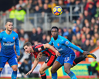 Danny Welbeck of Arsenal holds off Dan Gosling of AFC Bournemouth as Jack Wilshere of Arsenal left looks on during AFC Bournemouth vs Arsenal, Premier League Football at the Vitality Stadium on 14th January 2018