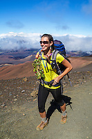 A backpacker follows the Sliding Sands Trail at Haleakala National Park, Maui.