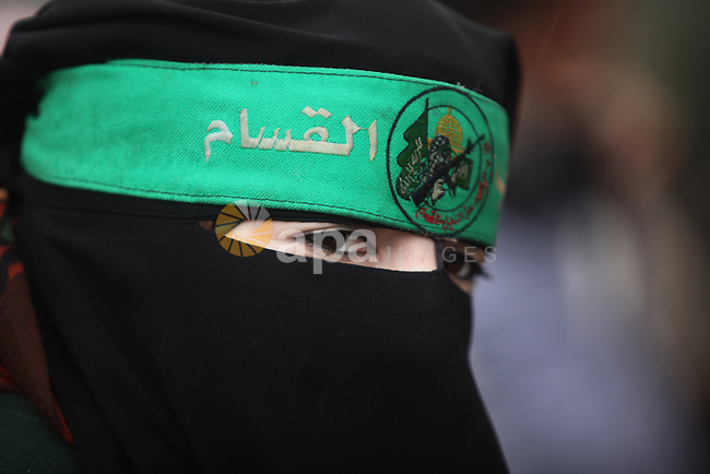 A Palestinian woman attends a military parade marking the 27th anniversary of Hamas' founding, in Gaza City December 14, 2014. Photo by Ashraf Amra