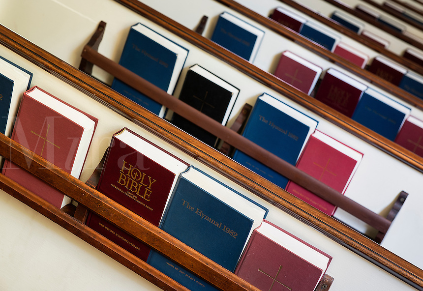 Pews with prayerbooks and hymnals.