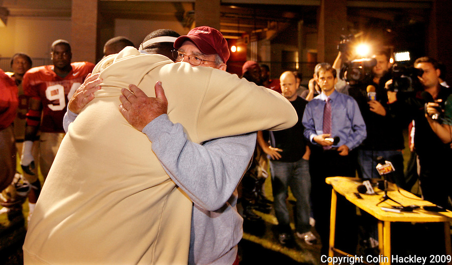 TALLAHASSEE, FL 11/3/09-FSU-ANDREWS RETIRE CH12-Florida State Defensive Coordinator Mickey Andrews is embraced by Defensive Tackles Coach Odell Haggins  after he announced that he will retire Feb. 10, 2010, Tuesday during a news conference in Tallahassee. ..COLIN HACKLEY PHOTO