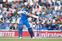 Shikhar Dhawan (India) guides backward of point during India vs Australia, ICC World Cup Cricket at The Oval on 9th June 2019