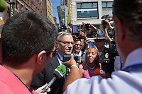 Cleveland, OH - July 19, 2016: Maricopa County Arizona Sheriff Joe Arpaio (c) is surrounded by members of the media and protestors as he walks to a checkpoint to enter the Quicken Loans Arena for the Republican National Convention in Cleveland, Ohio, July 19, 2016.  (Photo by Don Baxter/Media Images International)