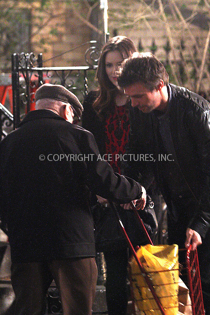 WWW.ACEPIXS.COM....October 10 2012, New York City....Actors Katharine McPhee and Jack Davenport find themselves blocking access to a senior citizen as he struggles with his shopping trolly on the set of the TV show 'Smash'. Davenport kindly picks up the trolly and schleps it up the steps on October 10 2012 in New York City........By Line: Zelig Shaul/ACE Pictures......ACE Pictures, Inc...tel: 646 769 0430..Email: info@acepixs.com..www.acepixs.com