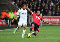 SWANSEA, WALES - FEBRUARY 21: L-R Wayne Routledge of Swansea is tackled by Ashley Young of Manchester United during the Barclays Premier League match between Swansea City and Manchester United at Liberty Stadium on February 21, 2015 in Swansea, Wales.