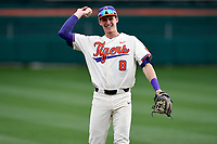 Shortstop Logan Davidson (8) of the Clemson Tigers warms up before a game against the Charlotte 49ers on Monday, February 18, 2019, at Doug Kingsmore Stadium in Clemson, South Carolina. Clemson won, 7-6. (Tom Priddy/Four Seam Images)